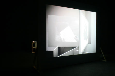video projection in a dark gallery