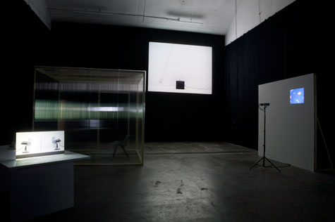 video installation in large dark gallery