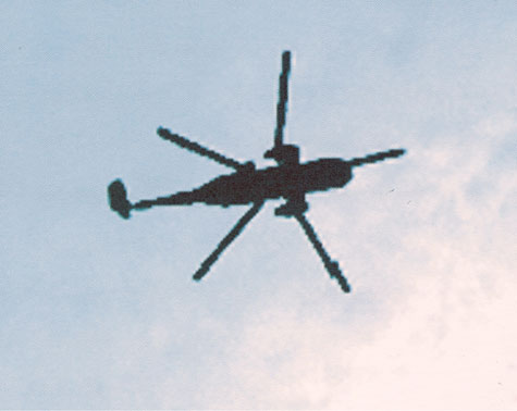 grainy image of a helicopter in flight